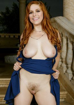 Busty redhead babe Penny Pax posing..