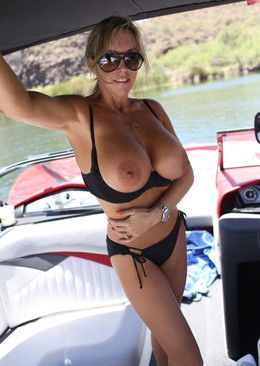 Big titted blonde wife topless on the..
