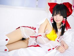 Playful asian cosplay girl with yummy..