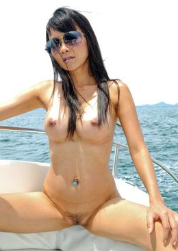 Busty Thai babe Mintra nude on a boat