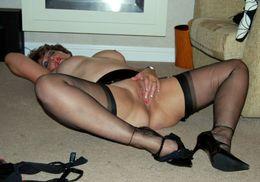 Housewife posing in black stockings..
