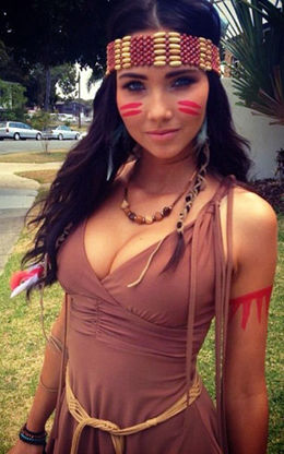 Young pretty woman dressed as an Indian.