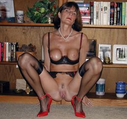 Tall mature ex-teacher posing in sexy..