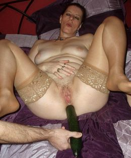 Curvy nude housewife with big cucumber..