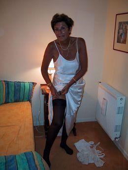 Skinny granny exposing her hairy twat..