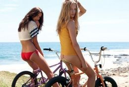 Sexy athletic girls naked on the bikes