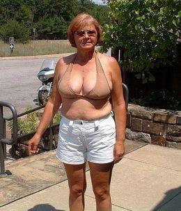 Dissolute granny sunbathing naked on..
