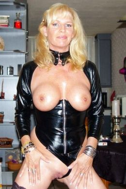 Mature lady in leather corset and..