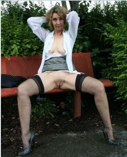 Horny mature business lady posing..