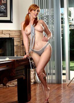 Sexy redhead model Lauren doffs..