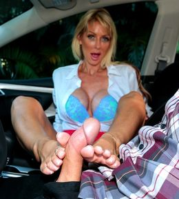 Cheerful MILF shows pussy upskirt in a..