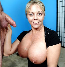Horny mature with giant boobs seduces..