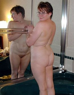 Pregnant wife in glasses posing nude..