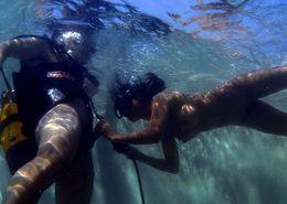 Asian scuba diver gives a BJ..