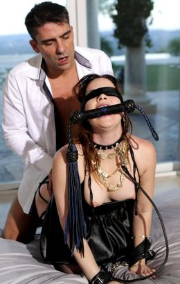 Blindfolded slave slut in black..