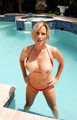 Outdoor pool posing of mature blondie..